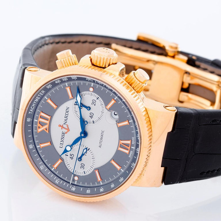 Ulysse Nardin Maxi Marine Chronograph Mens Watches - Automatic winding. 18K Rose gold  ( 41 mm ) . Two-toned dial in silver and slate gray with Roman numeral index hour markers . Black Ulysse Nardin with 18K rose gold deployant clasp . Pre-owned