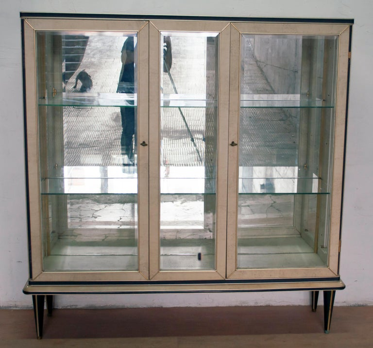 Bar cabinet designed by Umberto Mascagni of Bologna in the 1950s. The main structure is made of solid European wood, covered in cream-colored vinyl with anodized aluminium. Even the legs are covered with black vinyl! Excellent vintage condition!