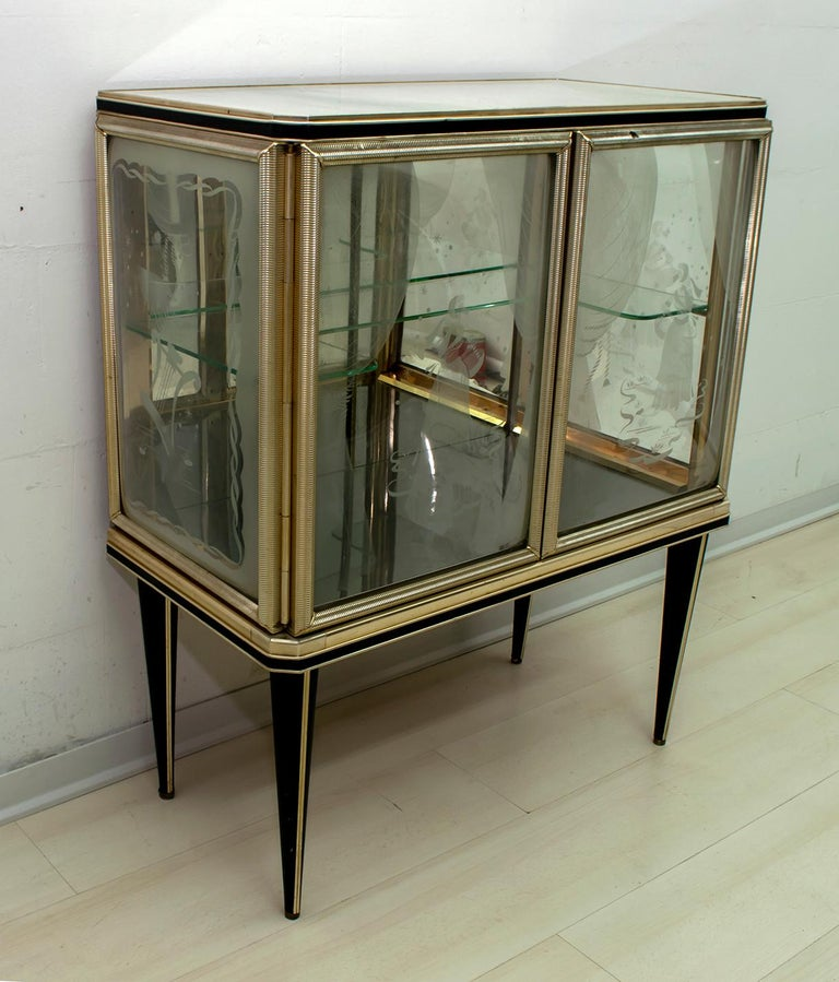 Bar cabinet designed by Umberto Mascagni of Bologna in the 1950s. The main structure is made of solid European wood, covered in cream-colored vinyl with anodized aluminum, decorated sanded convex glasses. Even the legs are covered with black vinyl!