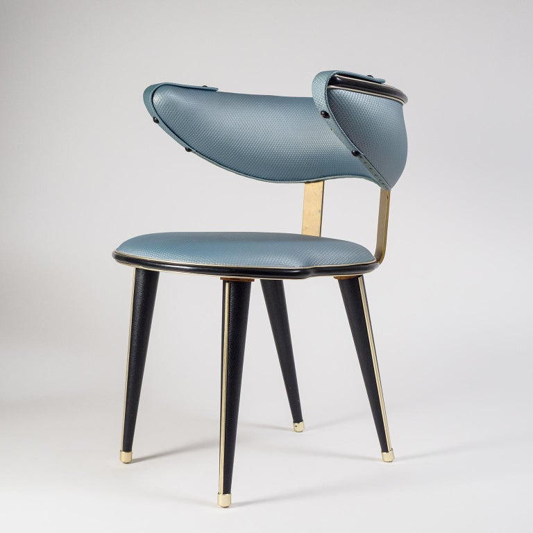 Lovely Italian side or vanity chair by Umberto Mascagni, circa 1960. The seat and armrest are upholstered in a rare metallic steely-blue colored leatherette with a geometric imprint, the wooden legs in black faux-leather. Additional details are in