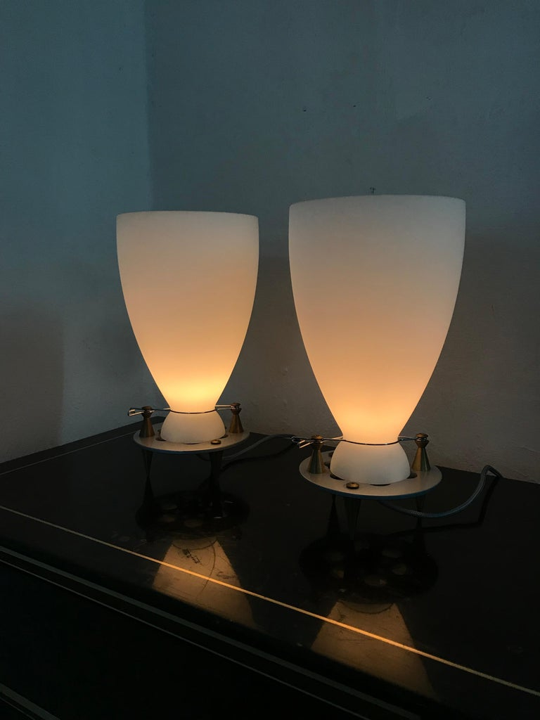 Beautiful and interesting table lamps by designed by Umberto Riva in 1989 for Fontana Arte in aluminum, bronze and Murano glass. There are 2 available.