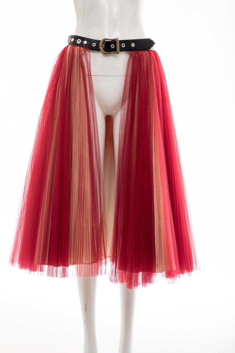 Undercover by Jun Takahashi, Spring-Summer 2016 red tulle,silver pleated, open front skirt with adjustable embellished leather belt at waist.  One Size  Waist: 30, Hip 38, Length 31.25