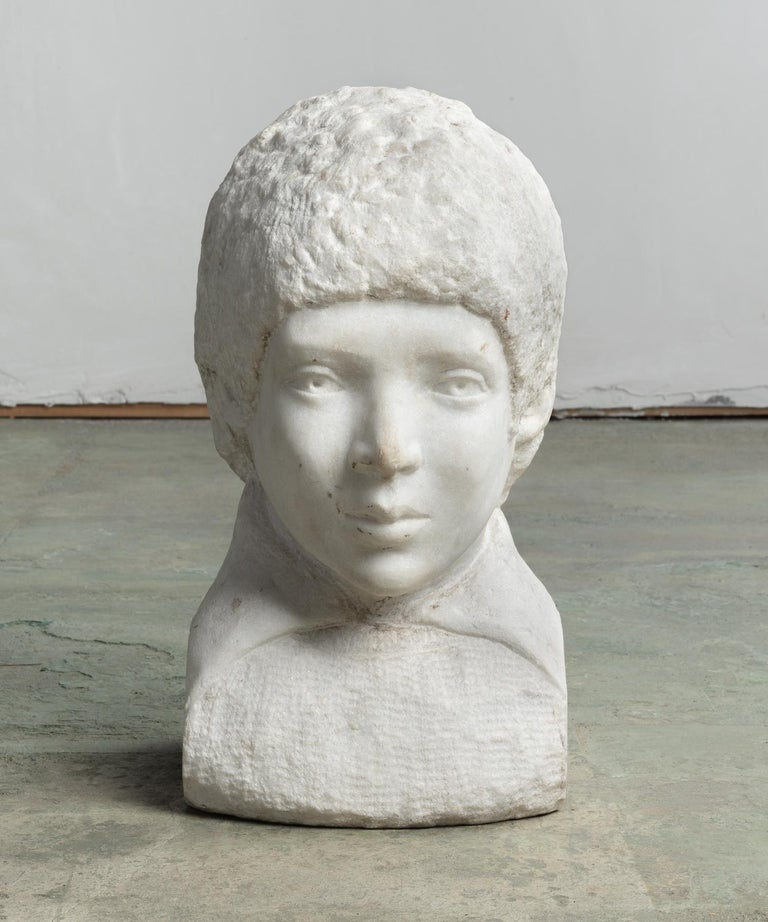 Marble bust, circa 19th century  Representation of a boy with a finely finished face and other roughly carved, un-finished elements.  This piece ships from Providence, Rhode Island.