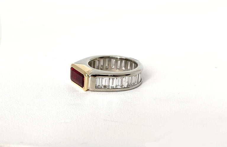 This eye-catching ring features a fine, red 2.00 carat emerald-cut unheated ruby and over 3 carats in baguette cut  diamonds! This fine, richly colored, red ruby is particularly notable in that it has been faceted as a step octagon, which is unusual