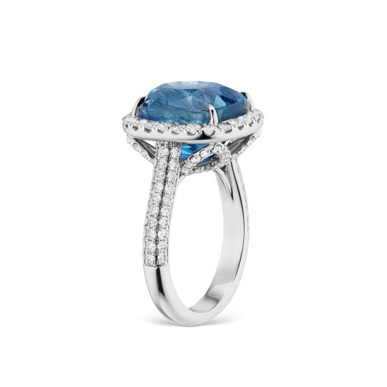 UNHEATED BURMA BLUE SAPPHIRE RING WITH DIAMONDS An exquisite snowy diamond halo surrounds a clear blue sapphire.Sapphire is Burmese & UN-Heated with AGL and GRS Certificate. Item:	# 03398 Setting:	18K W Lab:	GRS & AGL Color Weight:	12.57 ct. of