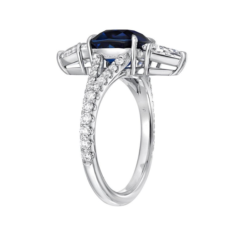GIA certified, Royal Blue, 3.04 carat unheated Ceylon blue Sapphire cushion, a pair of 0.91 carats total E/VS2 kite shaped diamonds, and a total of 0.40 carats round brilliant diamonds, are set together to compose this extraordinary hand crafted
