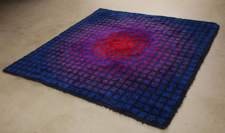 Large, square-format, long pile rya rug of Scottish and New Zealand wool. Made by the renowned Danish textile company Unika Vaev, circa 1968. In the style of Verner Panton or Vasarely, who are often credited with the design. The red-purple-blue