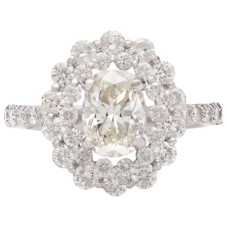 Unique 1.48 Carat Oval Diamond Halo Ring For Sale