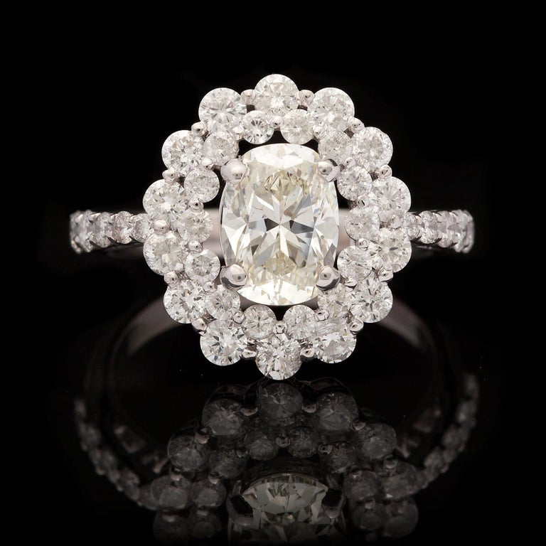 Women's Unique 1.48 Carat Oval Diamond Halo Ring For Sale