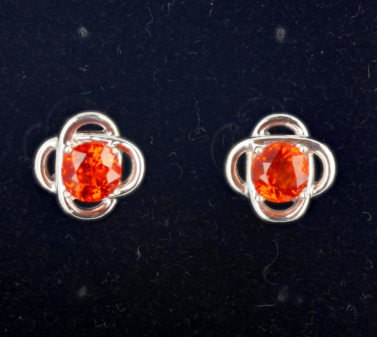3.22 carats of Glittering Reddish-Orangy brilliant Songea Sapphires (6.5 mm) set in lovely sterling silver stud earrings.  The earrings are approximately 13 mm across.  More from this jeweler by putting Gemjunky into your 1stDibs search bar.
