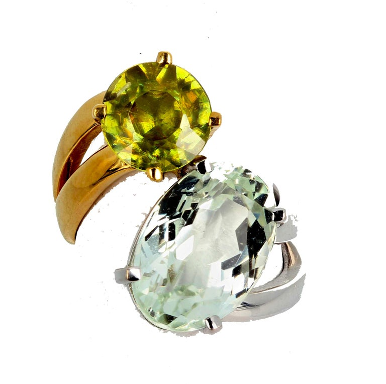 Rare unique glittering brilliant natural Amblygonite (14 mm x 9.8 mm) complemented by a gorgeous glittering green natural round Sphene (8.5 mm) set in an 18KT white gold and 18KT yellow gold ring size 5.  This is sizable but if you requested us to