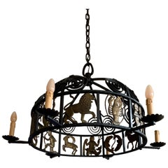 Unique and Large Arts & Crafts Wrought Iron Chandelier with Bronze Zodiac Signs