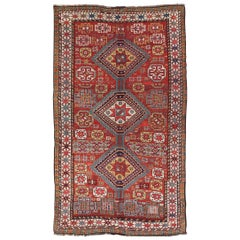 Unique Antique Qashqai Rug with Geometric Motifs in Red, Blue, and Golden Yellow