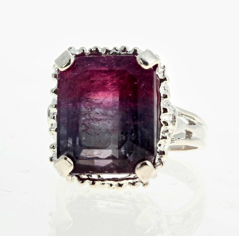 Large glowing 14.95 carat Bi-Color (purplish and red) emerald cut Tourmaline (12.7 mm x 14.9 mm) set in a sterling silver ring size 7 (sizable).    More from this seller by putting gemjunky into 1stdibs search bar.