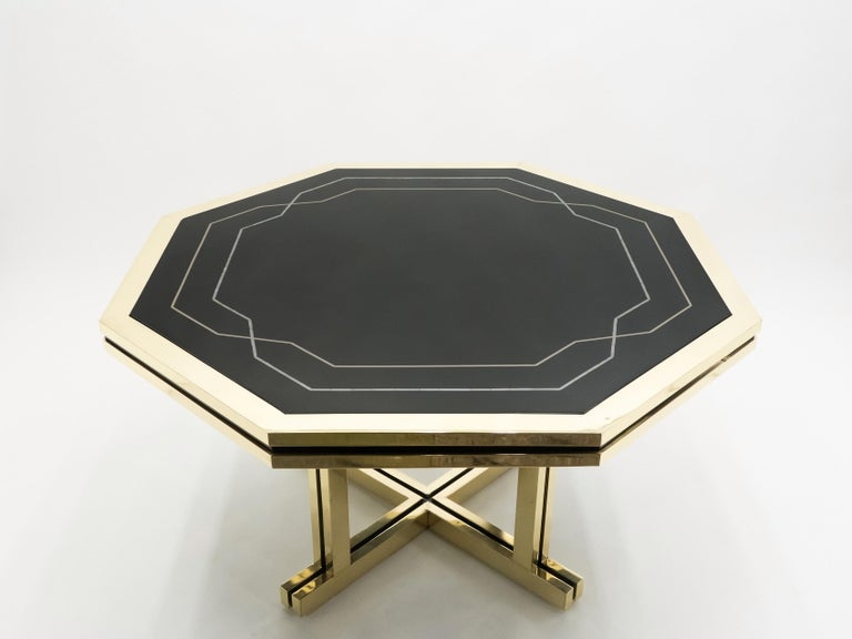 A rare piece from Maison Jansen, this octagonal dining table was a commission by a private client. With its impeccable design, perfect proportions, and high-end materials like mother of pearl lacquer and brass, it was likely a hugely expensive