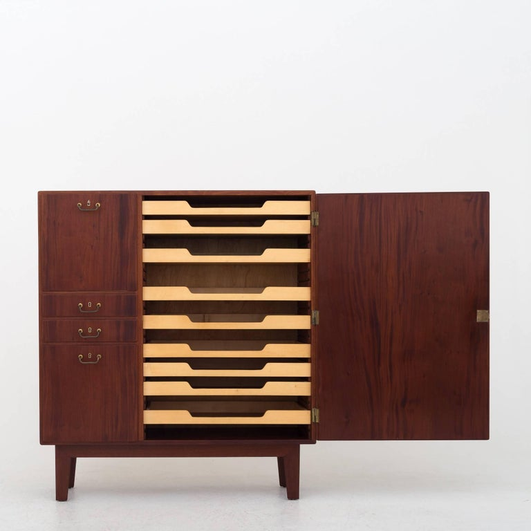 Unique cabinet in Cuban mahogany with handles of brass. Exhibited in 1938. Maker Niels Vodder. Exact cabinet shown on picture from cabinetmaker guild 1938 can be provided.