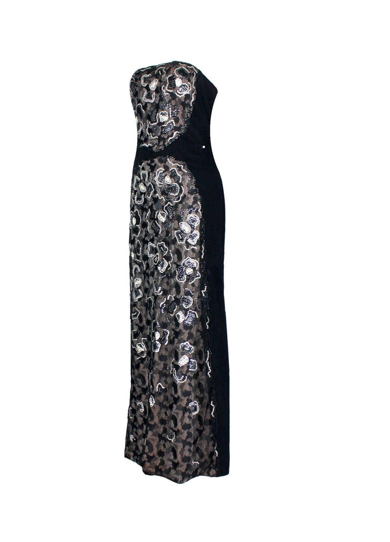 Stunning Chanel evening dress Designed by Karl Lagerfeld for Chanel Beautiful hand-embroidered camellia flowers in front Strapless gown with semi-corset inside for a perfect fit Closes with zipper in the back Chanel logo plate on side Made in