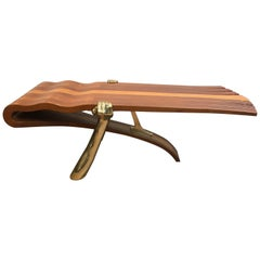 Unique Coffee Table Made of a Thick Freeform Wood Top Supported by Brass Arms