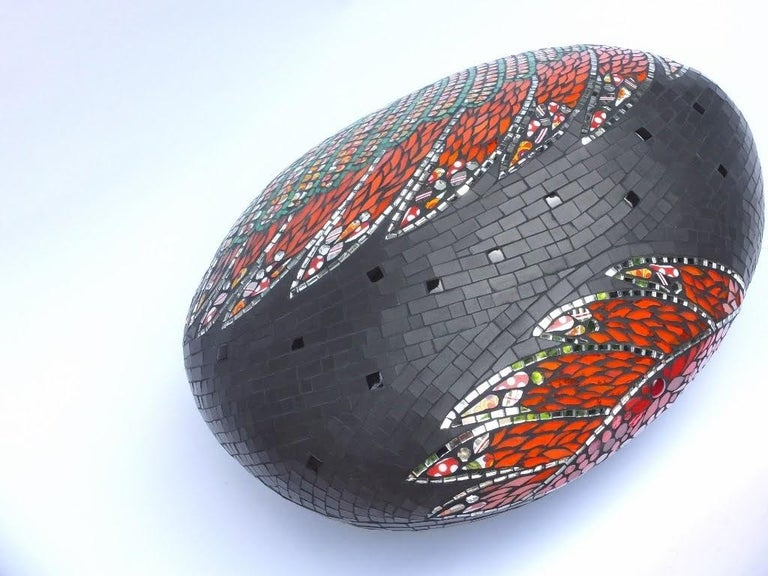 One of a kind mosaic ottoman pouf sculpture created using an original vintage small customized covered in fragments of ceramic, porcelain dishes, mirrors, glass, etc. All these different materials are gather together and handcut one by one. Then the