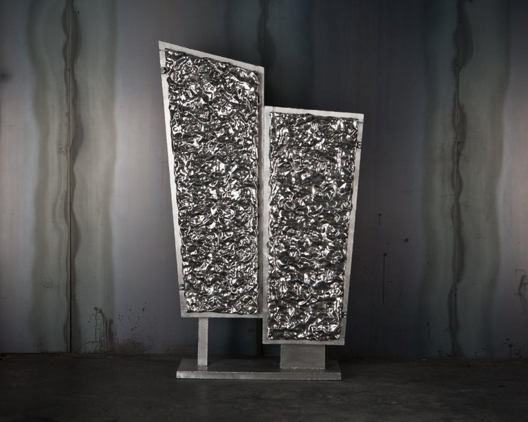 Michael Gittings Studio. Unique crinkle cabinet Hand beaten, polished aluminium and brushed aluminium. Measures: 197 cm 110 cm 42 cm.  Michael Gittings Melbourne based designer Michael Gittings aims to challenge pre-conceptions around