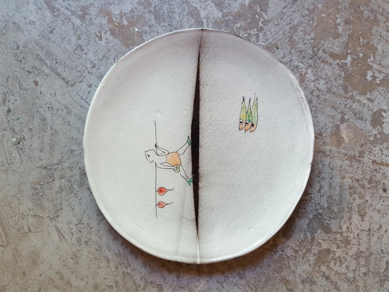 Ceramic earthenware Faience dinner plate artist creation, all handmade in France. Using plaques of dark Faience, graffiti, paint and enamel. Decoration hand-painted with the artist creative poetic characters limited edition. There are different
