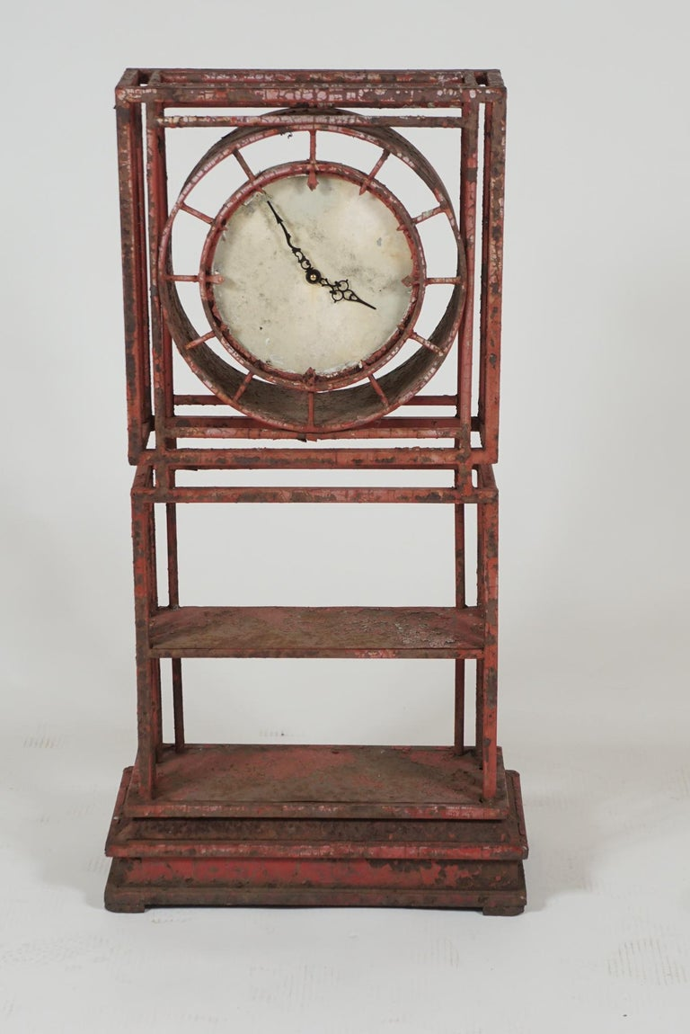 This clock constructed in iron and painted red. A sturdy form for outside in the garden. (The timepiece has been converted to battery operation)