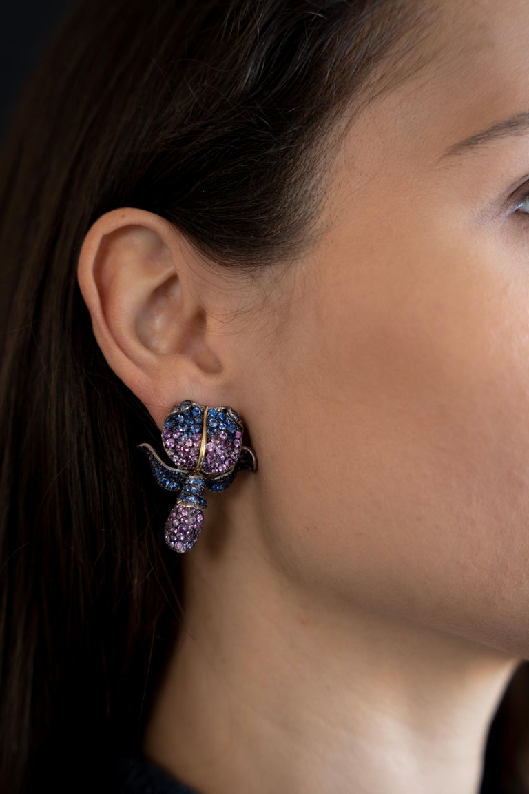 Round Cut Unique Glycine's Flower Ear Clips 18K Gold, pave set Emeralds and Sapphires For Sale
