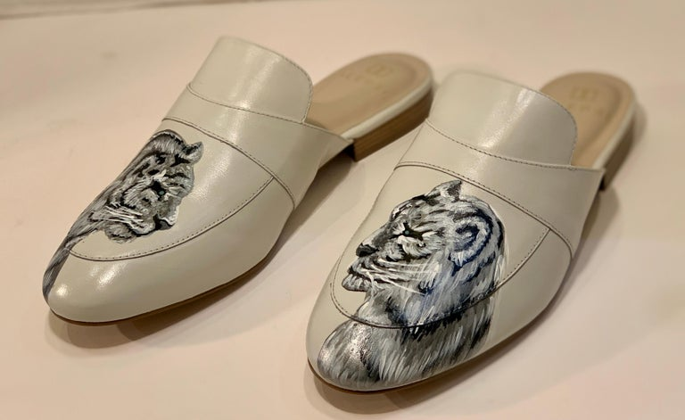 In a special partnership with Miami-based stylist, Irma Martinez, and ALEPEL, these special edition, elegant mules were designed using the mystique of jungle cats as inspiration.  Hand painted by a Cuban-born ALEPEL artist, the realistic rendering