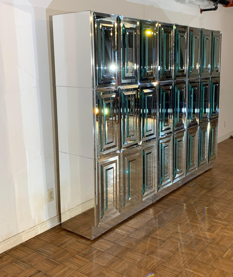 Unique custom ordered Mid-Century Modern Ello Furniture breakfront or sideboard with beveled mirrored doors polished chrome sides, includes dry bar and internal shelves and drawers. This wall of storage is comprised of 9 individual components,