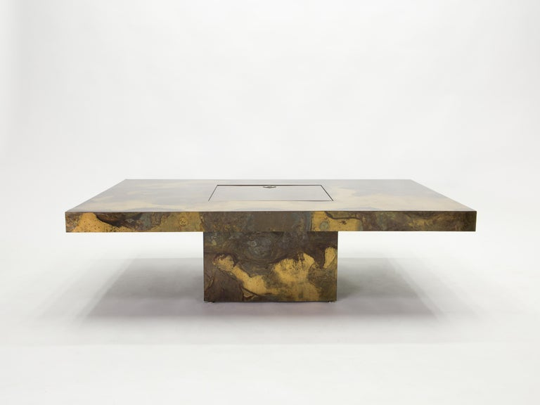 This unique large coffee table was created by Isabelle and Richard Faure for Parisian design firm Maison Honore in the late 1970s. Entirely covered by an incredibly decorated oxidized and patinated brass all over, that was then fixed and varnished.