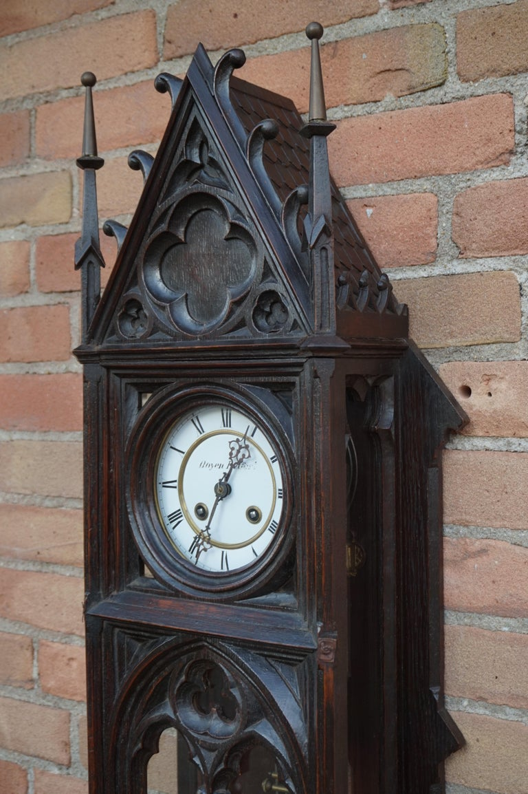 Stunning clock for the collectors of rare and truly stylish Gothic antiques.  Gothic wall clocks are a rare find and this more than three feet tall specimen probably is the best and the tallest we have ever seen. All hand-crafted & hand-carved