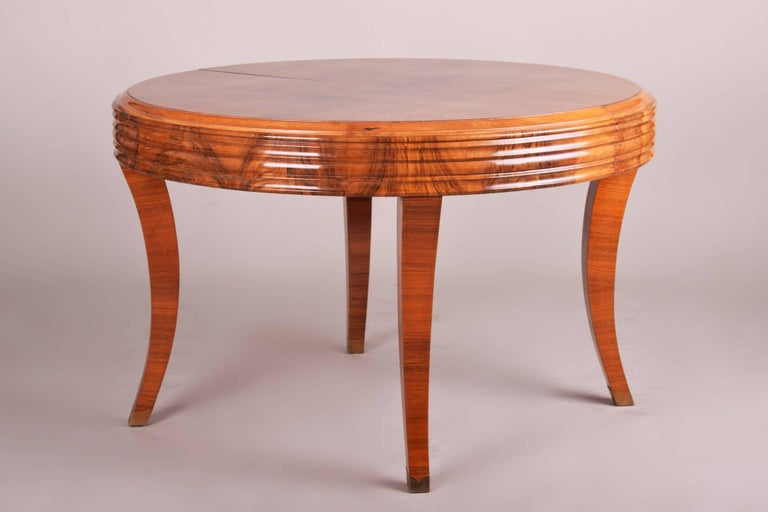 Art Deco extendable dining table Material: Walnut Completely restored. Surface polished by piano lacquers to the high gloss.  Dimensions after extending 187cm.  We guarantee safe a the cheapest air transport from Europe to the whole world within 7