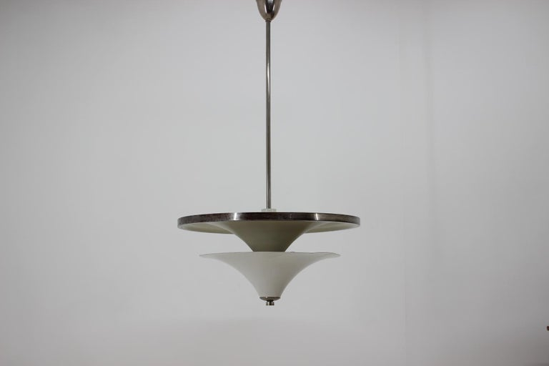 This large very rare Bauhaus chandelier with extraordinary shape was designed by Franta Anyz for IAS in 1930s. With two ways switch upper or lower bulbs could be turned on. Made from aluminium, steel and chrome. Beautiful and eye-catching piece! New