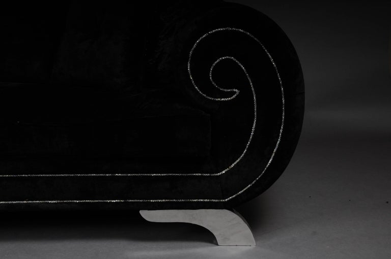 Unique luxurious designer sofa, rhinestones, black velvet. Highlight unusual and high-quality sofa in black velvet. Body refined with rhinestones. Sofa stands on four chrome feet. Very modern, comfortable and an absolute eye-catcher. Very noble and