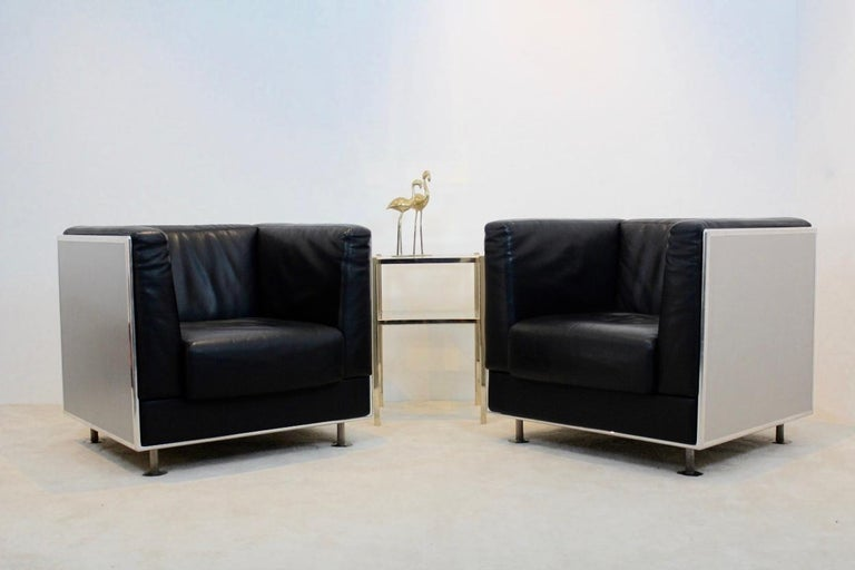 Set of unique two Italian black leather armchairs with an aluminium shell. Designed by Kunihide Oshinomi and manufactured by Matteo Grassi. These lounge chairs are extremely comfortable to sit in. The set has a very solid polished and anodized