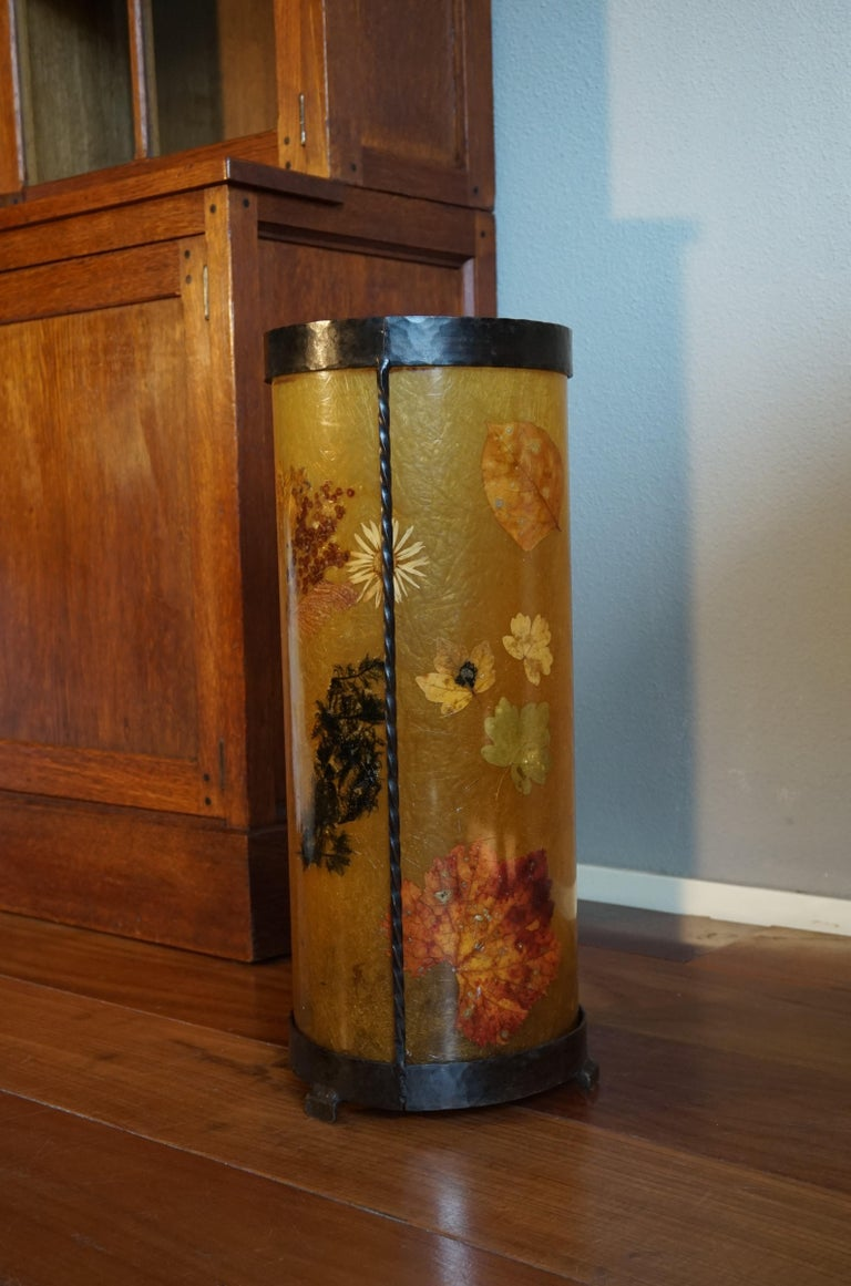 Beautiful design and great colors, resin or fiberglass umbrella stand inlaid with real flowers and leafs.  This striking stand is all handcrafted with a unique technique of inlaying real flowers and leafs into a resin body. We have never before seen