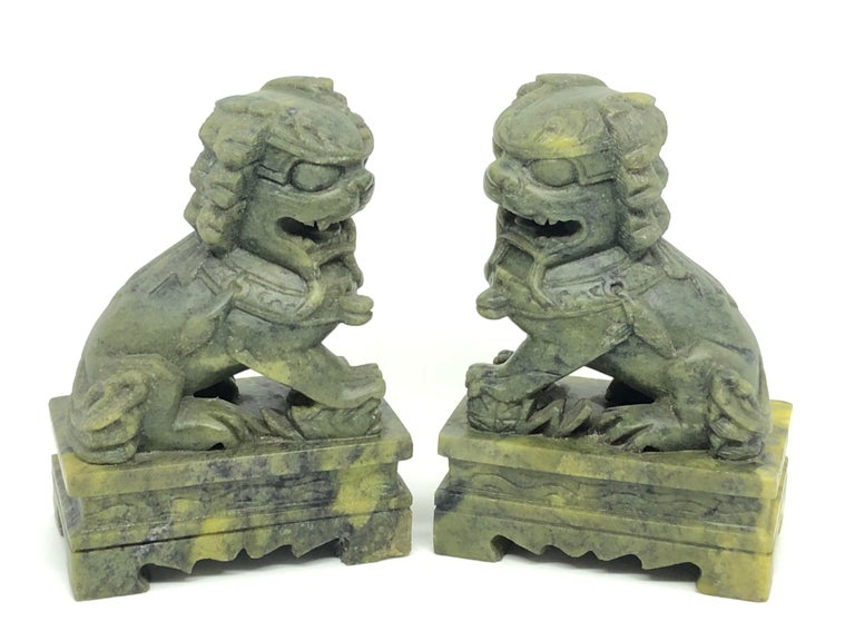 A pair of green colored marble foo dogs sculptures, book ends or decorative objects. Nice addition to any room.