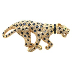 Unique Panther Brooch with Sapphires and Diamonds in 18 Karat Yellow Gold