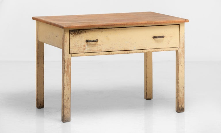 Unique Potters table, England, circa 1930  Pine construction with original paint and a unique swiveling drawer system.