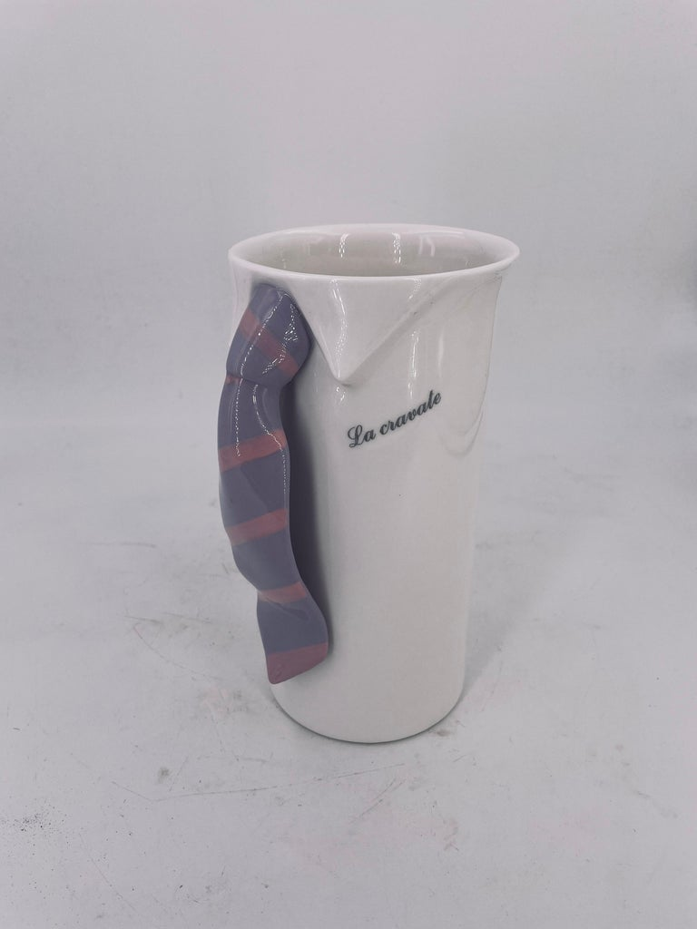Really cool and unique white porcelain pitcher circa 1980's, Made in Japan great Memphis era piece excellent condition with a tie handle, and a legend in Italian Le Cravate, The tie.