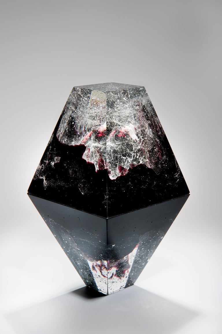 Unique Purple, is a clear and purple cast glass sculpture by the Norwegian artist Lene Tangen. Captured in the centre of this piece, suggestive of an iceberg, is an inner core of plaster. The glass surrounding this creates a magical, glistening
