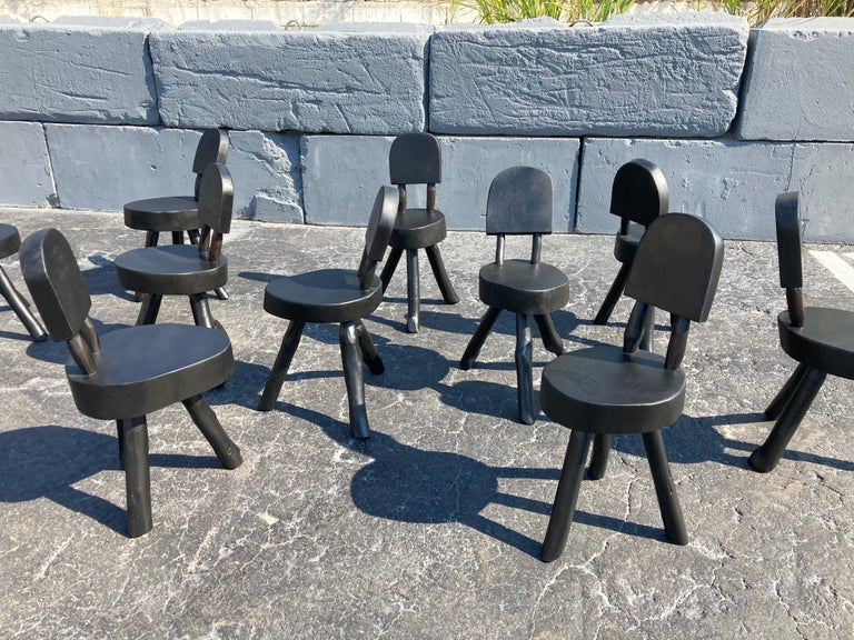 Set of ten tree dining chairs in black.