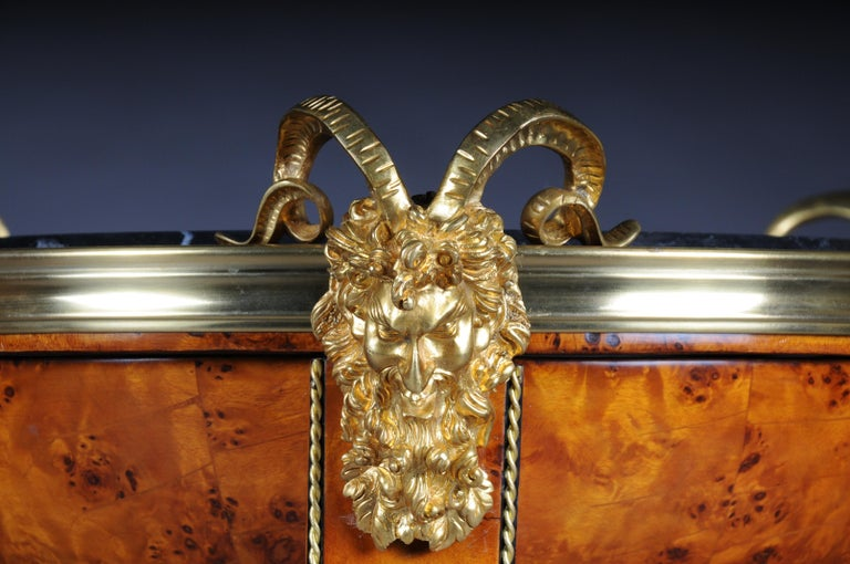 Maple root veneer on solid wood. Hemisphere with marble slab on satyr mask with tapered curly square legs in bronze lion paws ending on base plate retracted on three sides. The fittings are pronounced and of exceptionally good quality Honey-colored