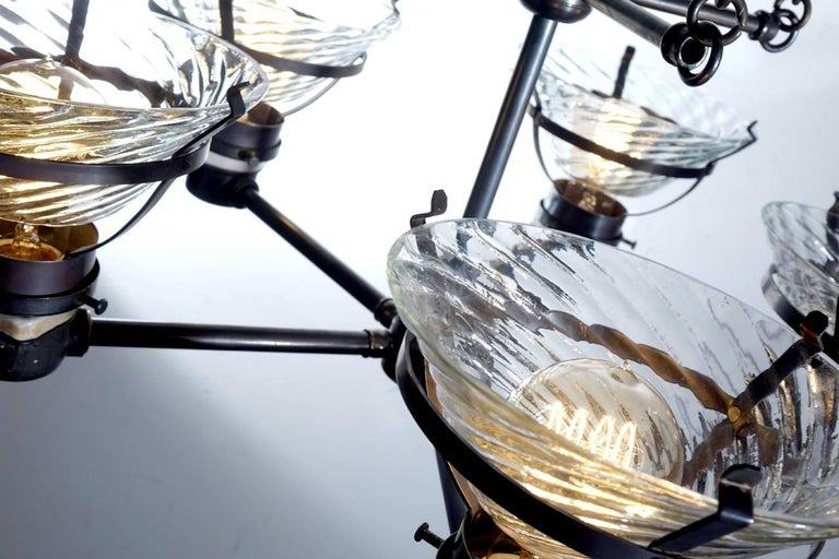 The skeletal nature of this lamp suggests that it once was the long-hidden workings of a more decorative fixture. Liberated from its original housing it's ready to make a statement all its own. The chandelier was manufactured by the national X-ray