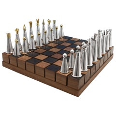 Unique Sterling Silver Chess Set on American Walnut board by Michael Benstead