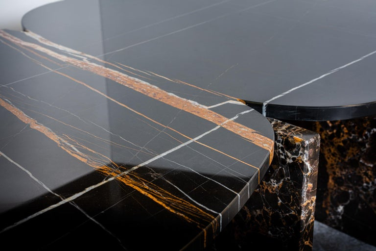 Unique trilithon marble coffee table - by Oskar Peet and Sophie Mensen Dimensions: 160 x 80 x 37 cm Materials: Sahara Noir (organic shapes) and Emperador gold (rectangular shapes) Other marbles or dimensions table could be made to