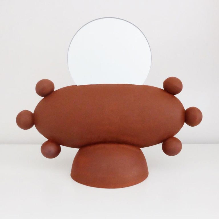 Unique UFO Mirror by Ia Kutateladze Dimensions: W 33 x H 26 cm Materials: Clay  UFO 02 is a hand built ceramic mirror. Playful and bold functional decorative object, for various types of interiors.  IAAI / Ia Kutateladze is a Georgian