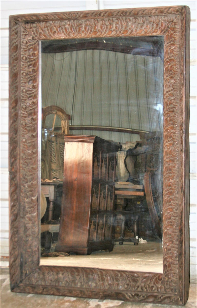 British Colonial Unique Unmatched Mirror Using Highly Carved Window Frame of a Colonial Era Home. For Sale