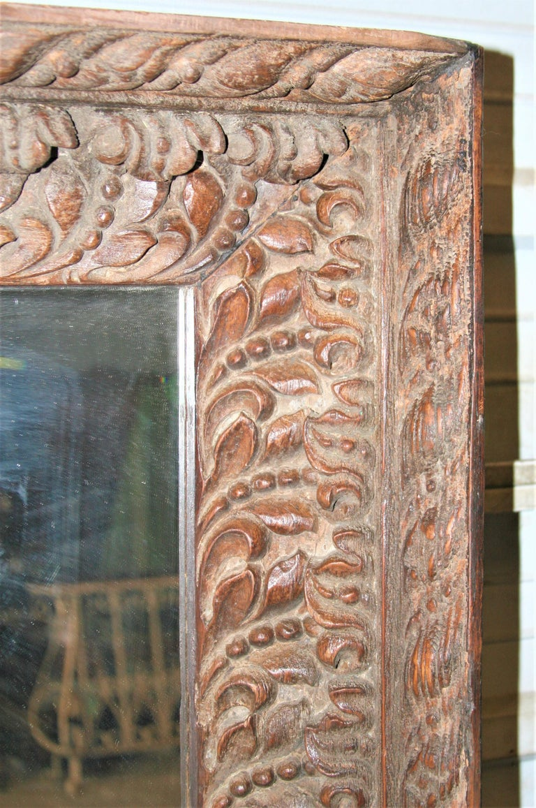 Unique Unmatched Mirror Using Highly Carved Window Frame of a Colonial Era Home. In Good Condition For Sale In Houston, TX
