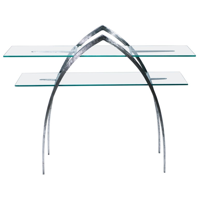 Beautiful wrought iron and glass console inspired by the work of Sylvain Subervie. The iron structure is sharp and imposing from a distance, two pointed arches and spears serving as the only elements. Sheets of transparent glass, forming two table